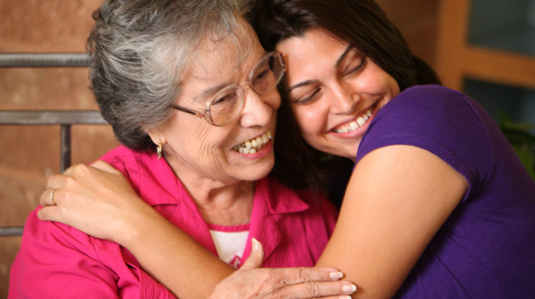 image-young woman hugging grandmother