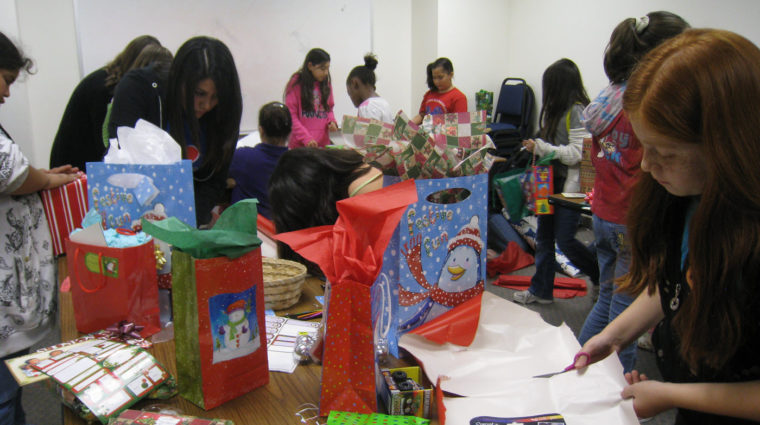 image-ywteens volunteer to wrap for holiday shop